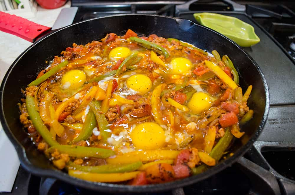 Eggs cooking in Chorizo and peppers