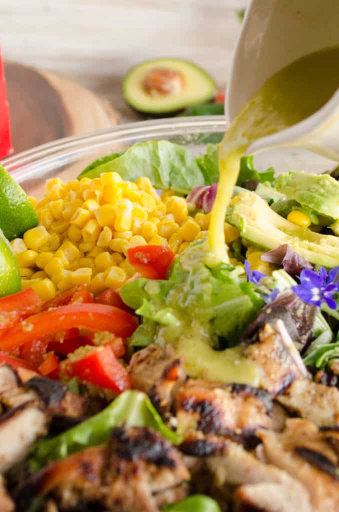 Southwestern Grilled Chicken Salad dressing is poured over freshly grilled chicken- The Goldilocks Kitchen