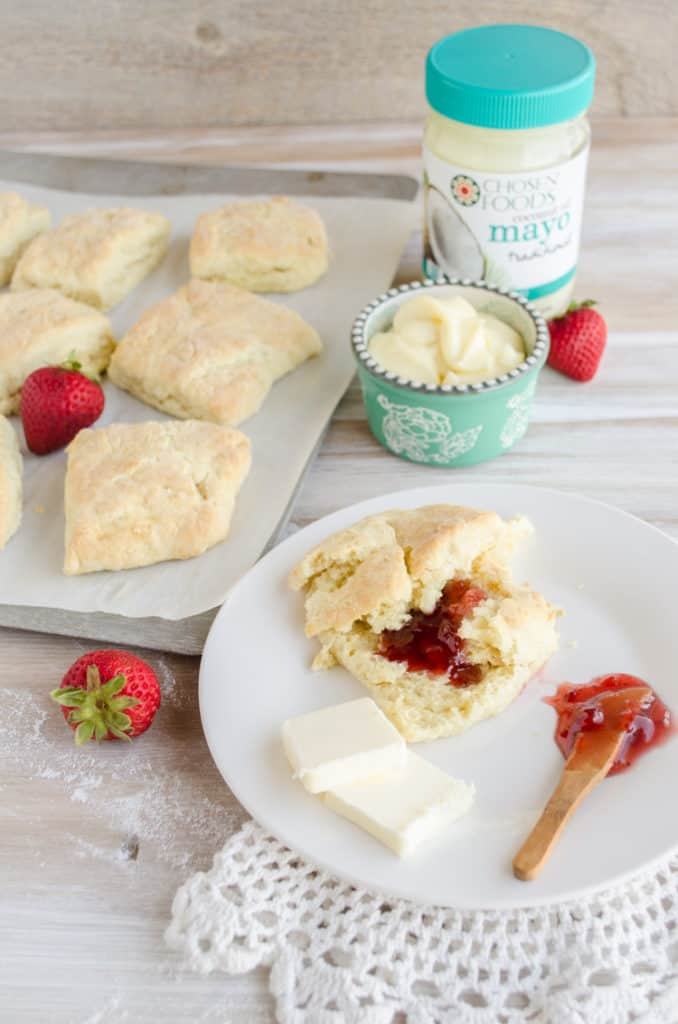 Quick Fluffy Coconut Biscuits shown with a jar of Chosen Foods Coconut Oil Mayo.