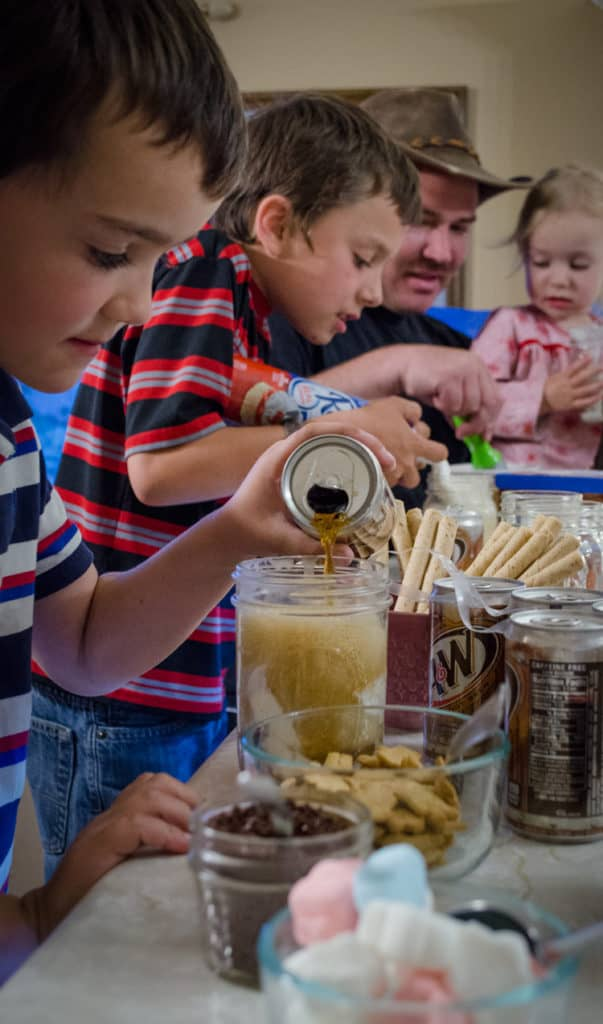 Children assemble their root beer floats for a Family Night Root Beer Float Bar.