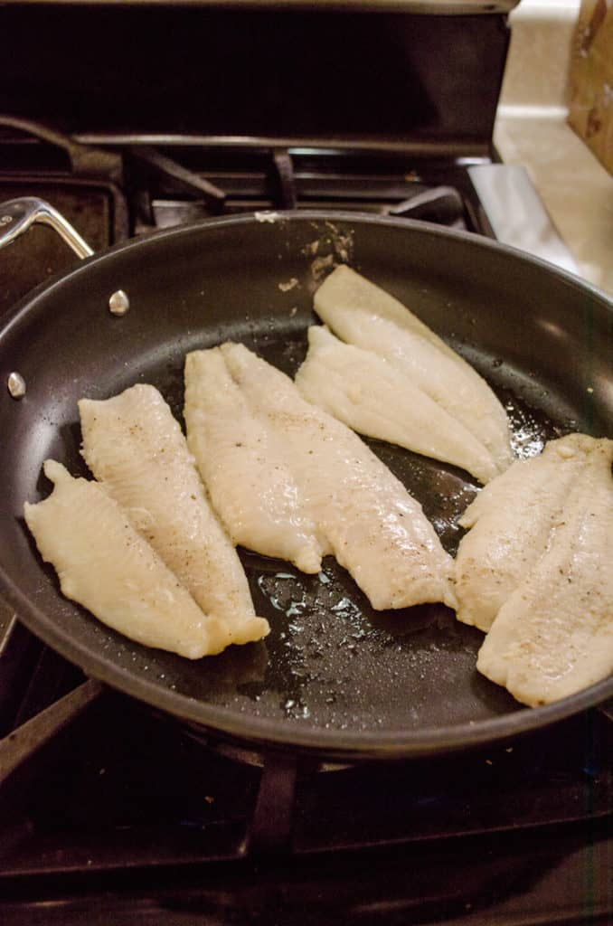 Fish frying in a non-stick frying pan for Fast Fish Dinner with Herbed Browned Butter recipe.
