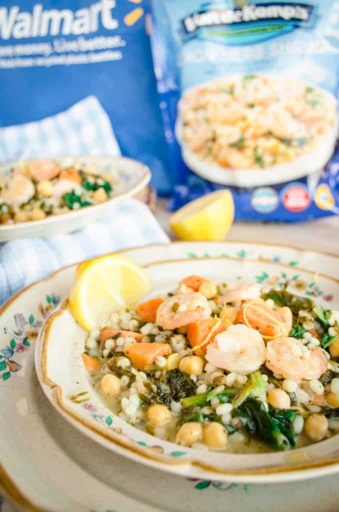 A plate of Van de Kamp's Seafood and Veggie Meals for Fish on Friday featuring Lemon Herb Shrimp with Chickpeas, Sweet Potatoes, and Spinach with a lemon wedge - The Goldilocks Kitchen