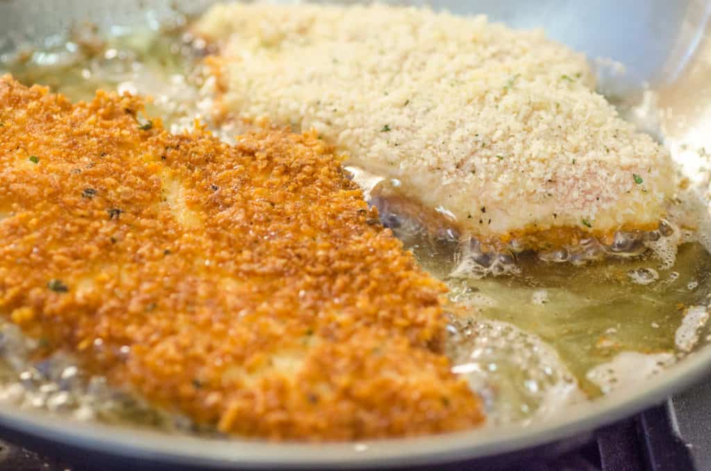 Breaded chicken cutlets are pan fried in vegetable oil until beautifully deep golden brown.