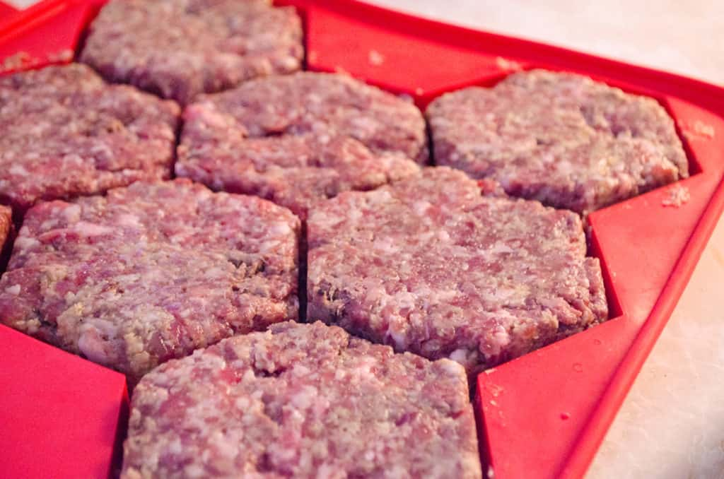 Meatloaf Burgers are pressed into a silicone burger mold.