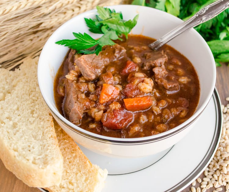A bowl full of Slow Cooker Beef and Barley Stew.