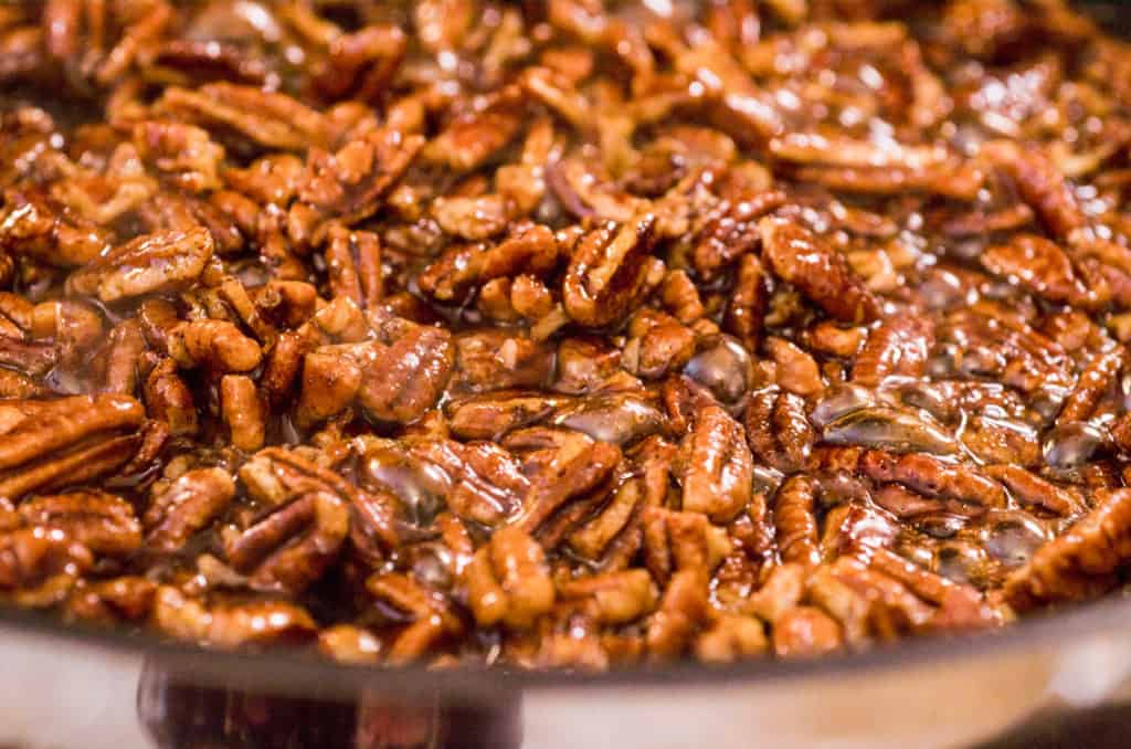 Candied Spice Pecans bubble and cook in a non-stick skillet - The Goldilocks Kitchen