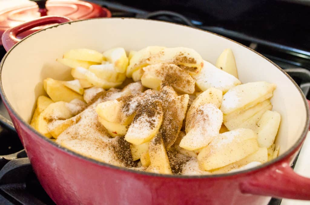Apples, sugar, spices and green chiles are mixed and par cooked on the stove to make Green Chile Apple Pie - The Goldilocks Kitchen