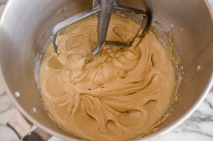 Peanut butter, butter and sugar are creamed together in a mixing bowl for Dove Peanut Butter Buttons cookies - The Goldilocks Kitchen