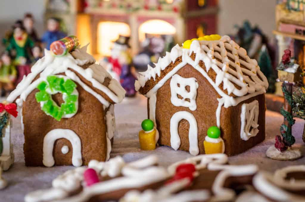 Easy Gingerbread Cookies recipe is also great for gingerbread houses. Here are two mini-houses displayed in a miniature Christmas village- The Goldilocks Kitchen