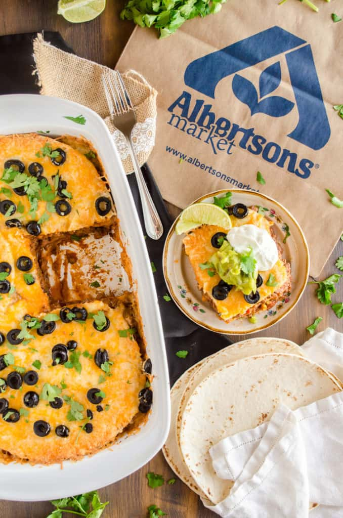 A white casserole dish with 30 Minute Mexican Lasagna and an Albertsons shopping bag - The Goldilocks Kitchen