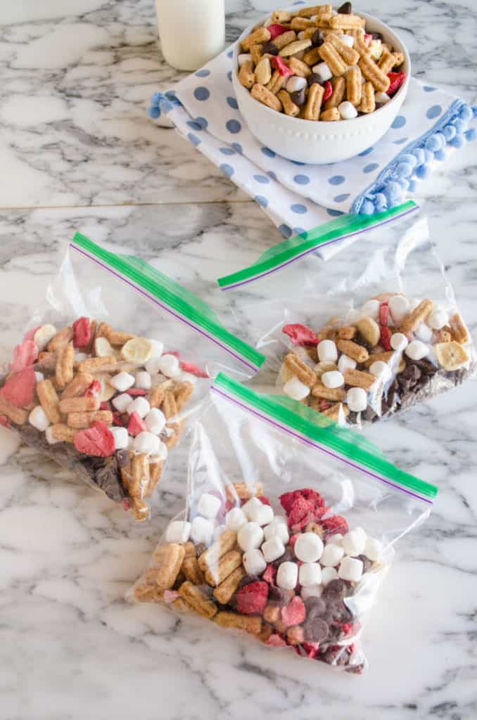 Churros Snack Mix in baggies on a counter - The Goldilocks Kitchen