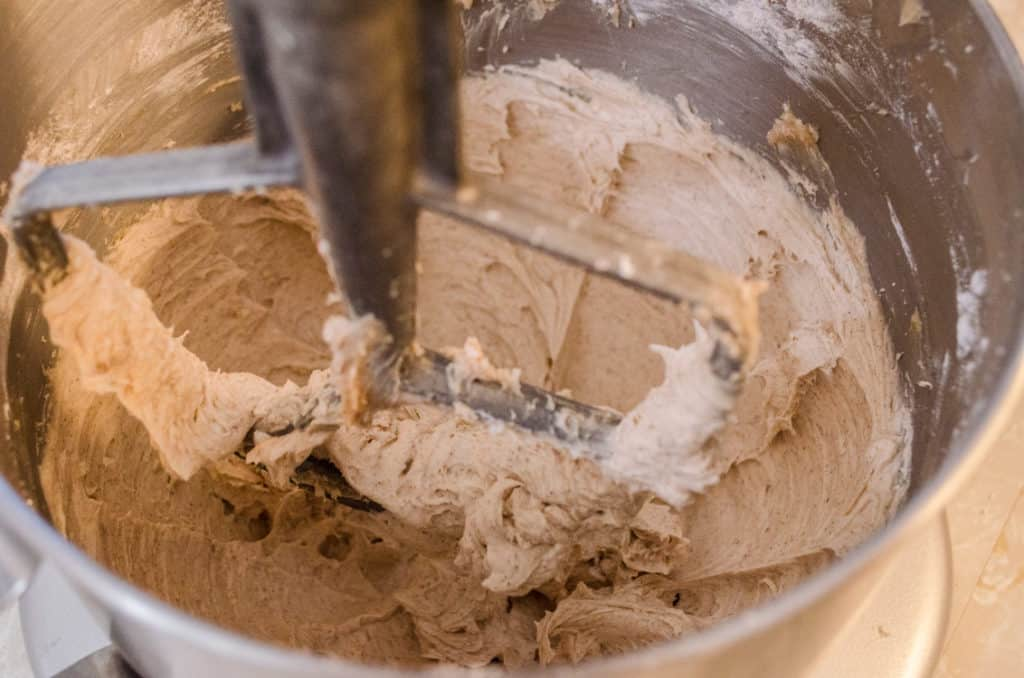 Whipping up a batch of Cinnamon Buttercream Frosting in a stainless steel stand mixer bowl- The Goldilocks Kitchen