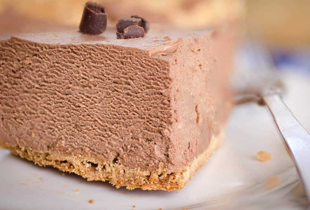 Closeup picture of a wedge slice of French Silk Pie without Raw Eggs showing the velvety chocolate texture- The Goldilocks Kitchen