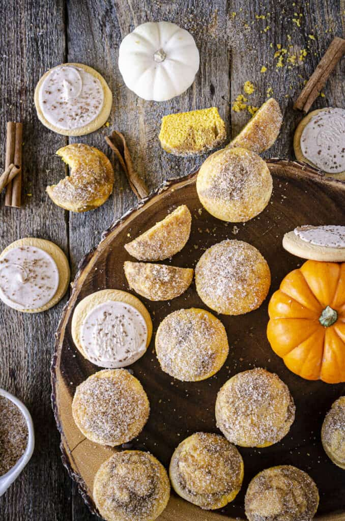 Looking down on a wooden table covered with Snickerdoodle Pumpkin Muffins