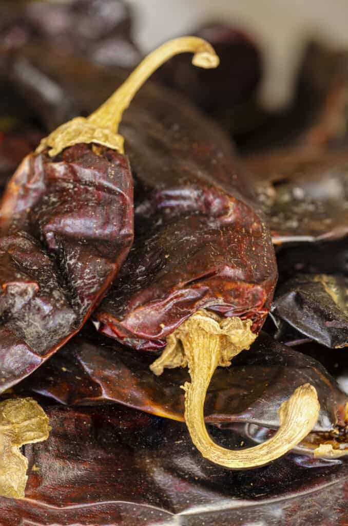 A close-up of dried red chile pods.